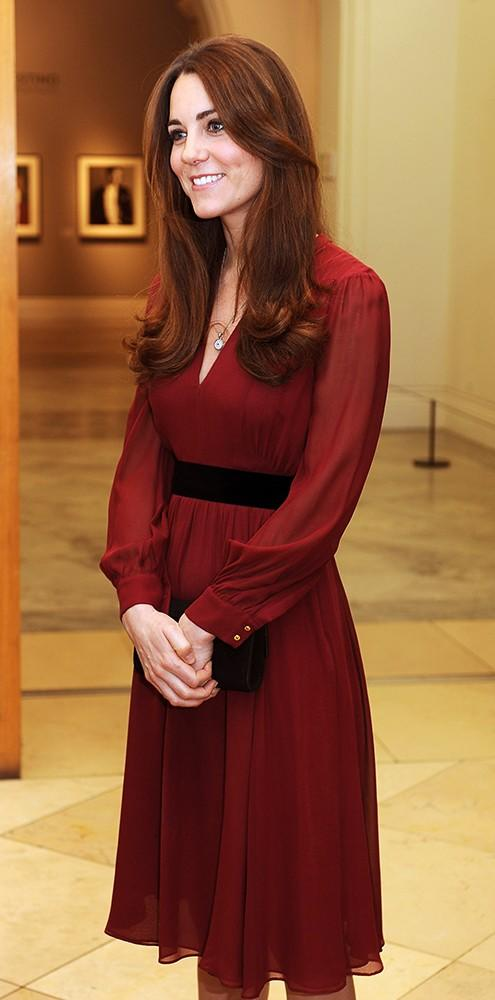 Kate looks on in a prettyWhistles dress after viewing her first official portrait.