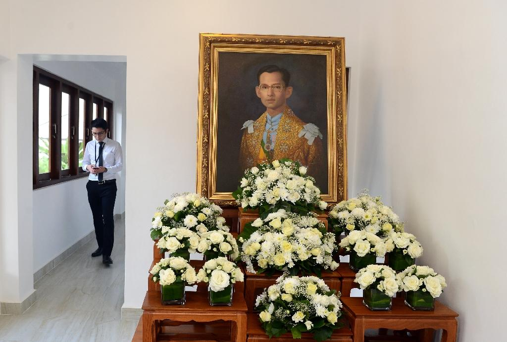 The death of long-serving King Bhumibol Adulyadej is being marked by an intense period of national mourning in Thailand, where he was seen as a stabilising father figure in troubled times (AFP Photo/Lakruwan Wanniarachchi)