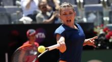 Injured Halep '50-50' for French Open