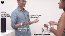 Ultrasonic bracelet jams the microphones around you