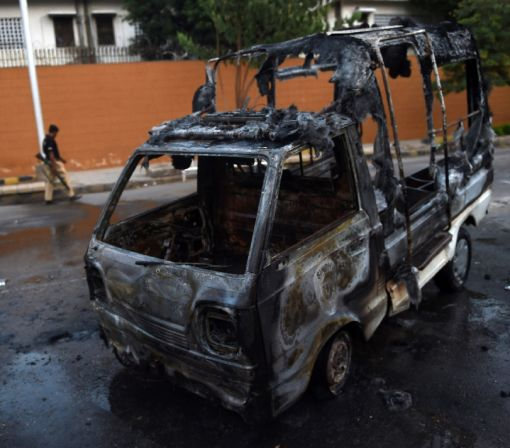Protesters attack Pakistan TV station, one dead