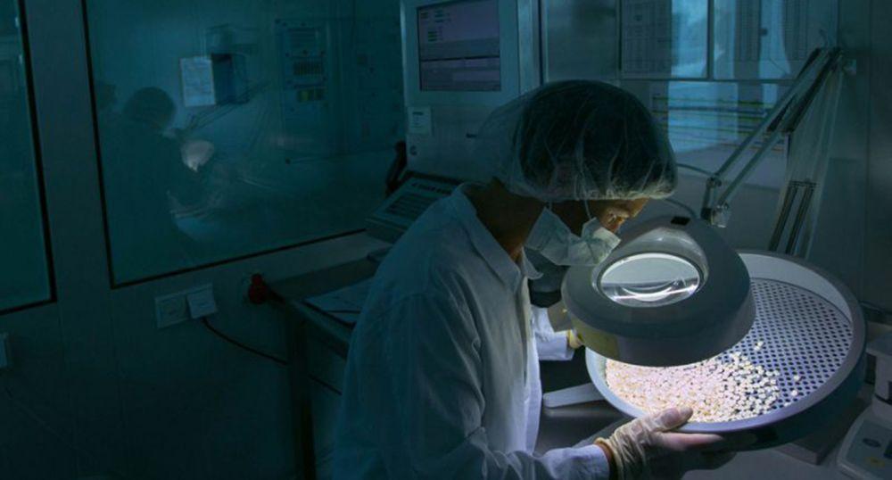 Novartis lab worker (Krisztian Bocsi/Bloomberg)