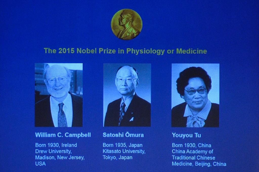 The portraits of the winners of the Nobel Medicine Prize 2015 (L-R) Irish-born William Campbell, Satoshi Omura of Japan and China's Youyou Tu are displayed on a screen during a press conference of the Nobel Committee (AFP Photo/Jonathan Nackstrand)