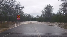 Swollen River Makes Waves Across Queensland Road