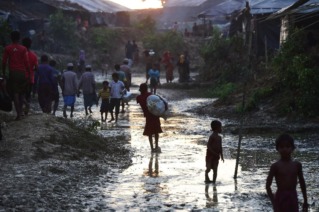 A Rohingya girl walks through a refugee camp in the Bangladeshi district of Ukhia