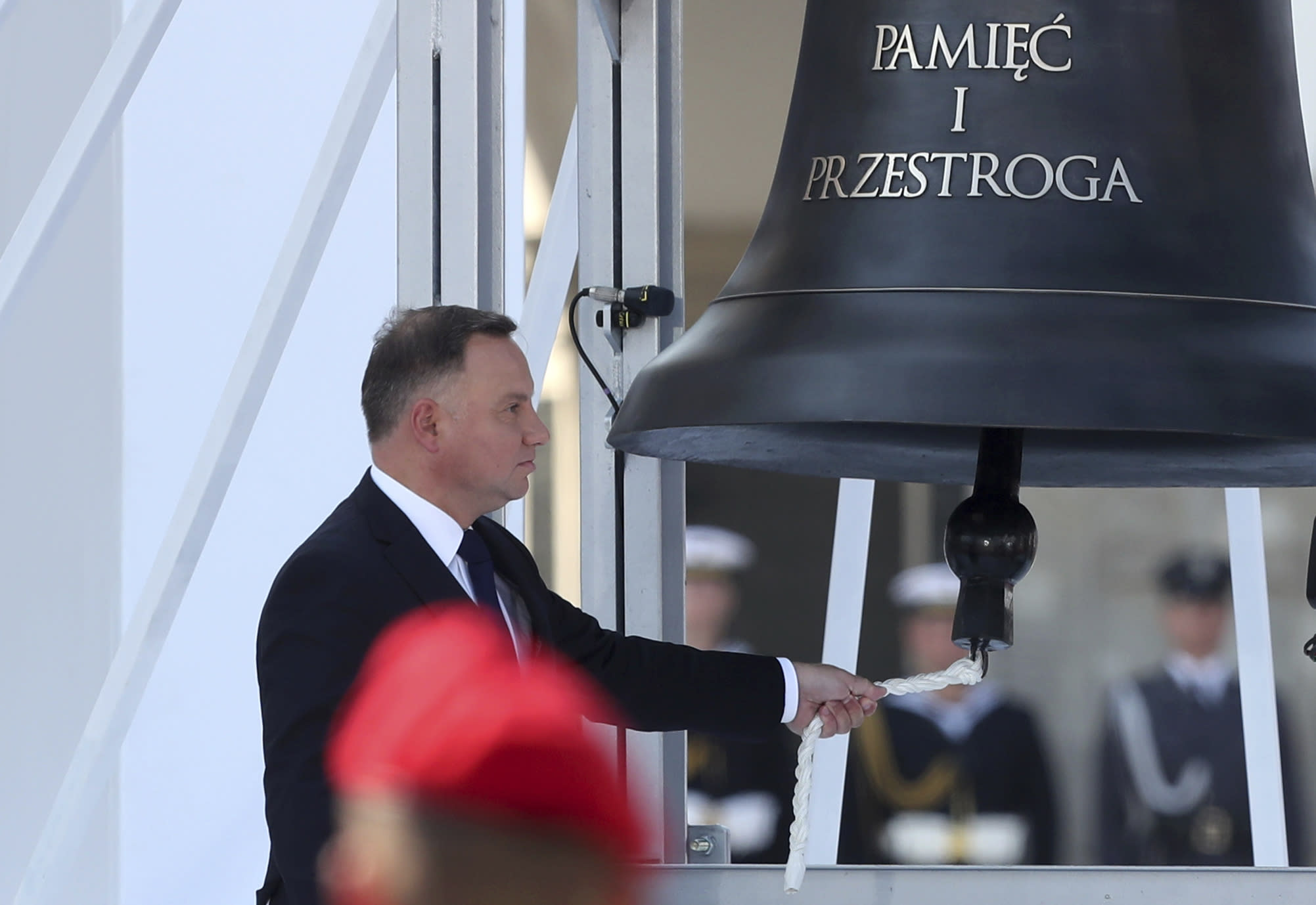 Polish President Andrzej Duda rings the Bell of Memory and Warning during a memorial ceremony marking the 80th anniversary of the start of World War II in Warsaw, Poland, Sunday, Sept. 1, 2019.(AP Photo/Czarek Sokolowski)