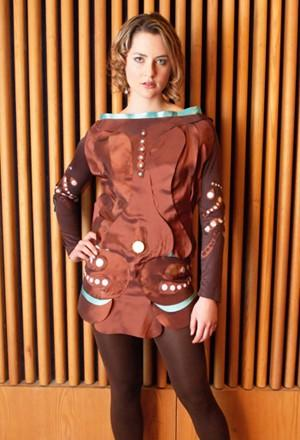 Piezing dress generates power, attracts nerds as wearer moves