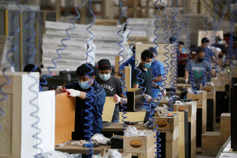 U.S. manufacturing snaps back; new COVID-19 cases threaten recovery