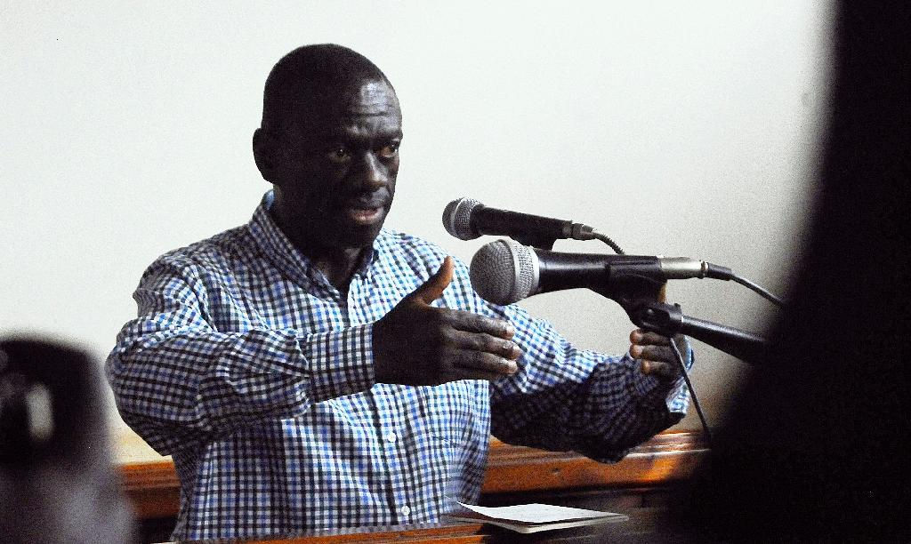 Uganda's main opposition leader Kizza Besigye gives evidence during his trial for treason in Kampala, on May 18, 2016