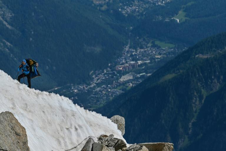 A climber heading toward the Mont Blanc on a ridge overlooking Chamonix, France, whose mayor is asking President Emmanuel Macron for tough new laws to preserve the site
