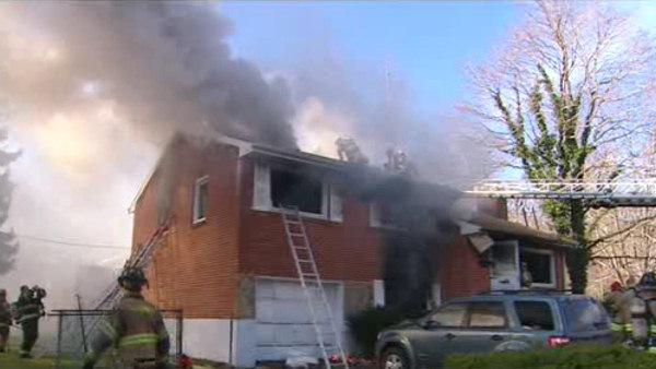 Man pulled from burning home in Delaware dies