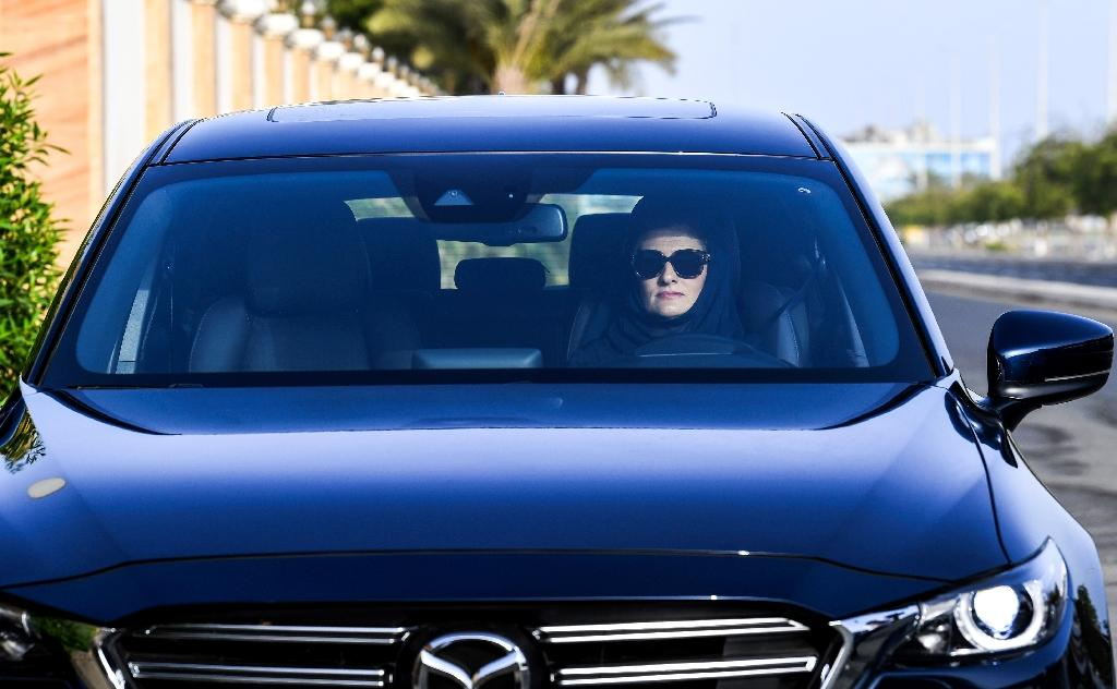 Hala Hussein Alireza, a newly-licensed Saudi motorist, drives a car on a main road in the Red Sea coastal city of Jeddah (AFP Photo/Amer HILABI)