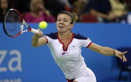 Halep of Romania returns a shot to Stosur of Australia during the Tournament of Champions women's singles final tennis match in Sofia