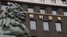 Asian markets mixed as Wall Street retreats from record highs