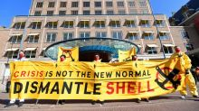 """Protesters chant """"Shell must fall"""" at oil major's meeting"""
