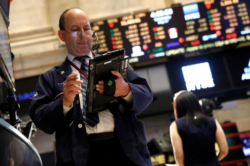 A trader works on the floor of the New York Stock Exchange near the closing bell of the trading session in New York City