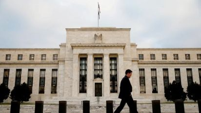 Fed raises interest rates by a quarter point