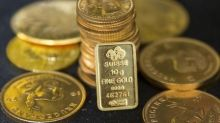 Gold flat after rising above $1,300 as Trump's chief strategist resigns