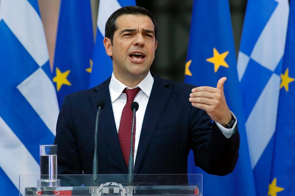 Greek Prime Minister Alexis Tsipras announced his country was 'turning a page' after eurozone ministers declared its crisis over in June (AFP Photo/Milos Bicanski)