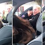 Shocking vision of hair pulling exchange between woman and police officer