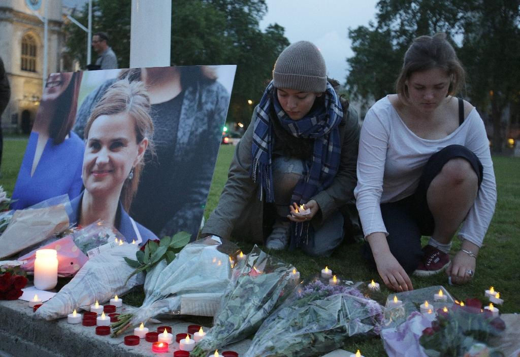 Floral tributes and candles are placed by a picture of slain Labour MP Jo Cox at a vigil in Parliament square in London (AFP Photo/Daniel Leal-Olivas)