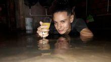Vítima da enchente, jovem faz ensaio bem humorado na água e viraliza