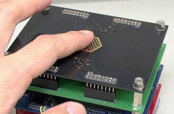 Touch pad prototype works without movement, makes fingertips feel like they're sliding (video)