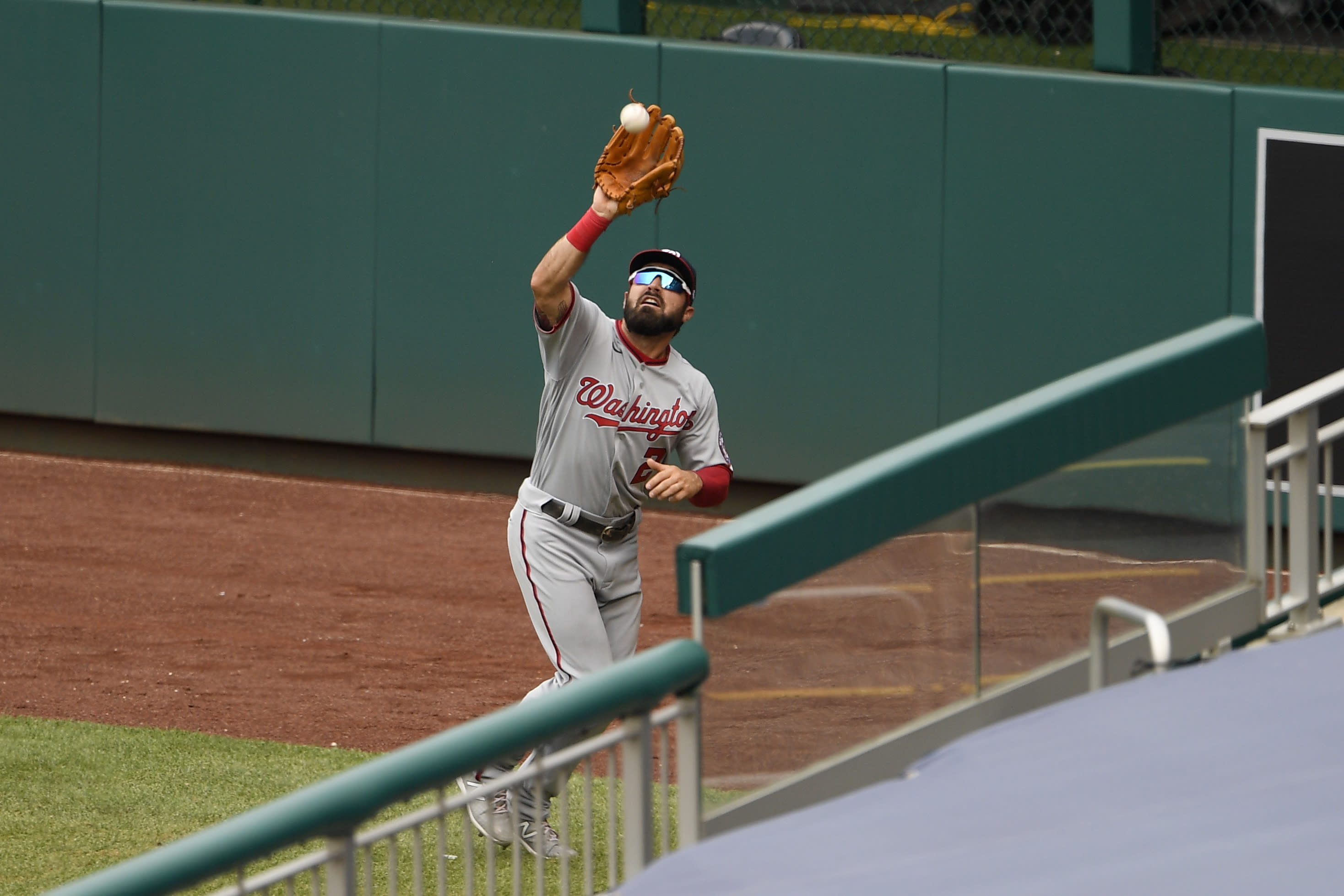 Washington Nationals right fielder Adam Eaton makes a catch on a fly ball by Toronto Blue Jays' Bo Bichette during the third inning of a baseball game Thursday, July 30, 2020, in Washington. (AP Photo/Nick Wass)