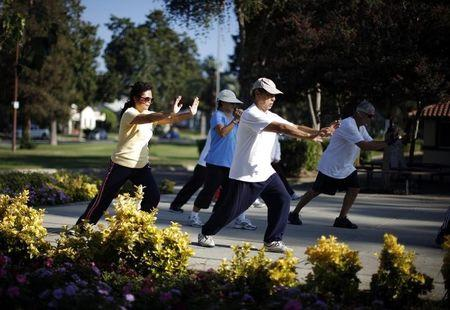Johney Yu and Diana Yang, both immigrants from China, practice tai chi at a daily class in Alhambra