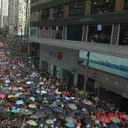 Chanting Anti-Beijing Slogans, Protesters Defy a Police Ban to March Through Downtown Hong Kong