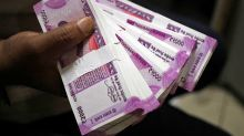 Rupee falls 14 paise against US dollar in early trade