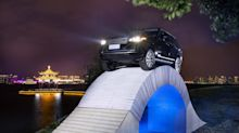 Watch An SUV Drive Over A Bridge Made From 54,000 Sheets Of Paper