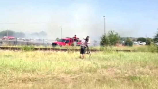 Raw video: Crews fight wildfire near airport