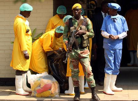 Soldiers stand guard as President Emmerson Mnangagwa visits cholera-affected patients in Harare, Zimbabwe, September 19, 2018. REUTERS/Philimon Bulawayo
