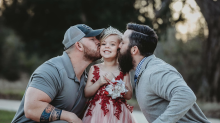 Photo of girl, 5, posing with birth dad and 'bonus dad' for father-daughter dance goes viral