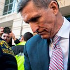 Trump suffers double whammy as Michael Flynn is accused of 'selling out his country' and president's charity shuts
