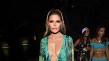 Lisa Rinna channels Jennifer Lopez with replica of green Versace dress at Halloween party