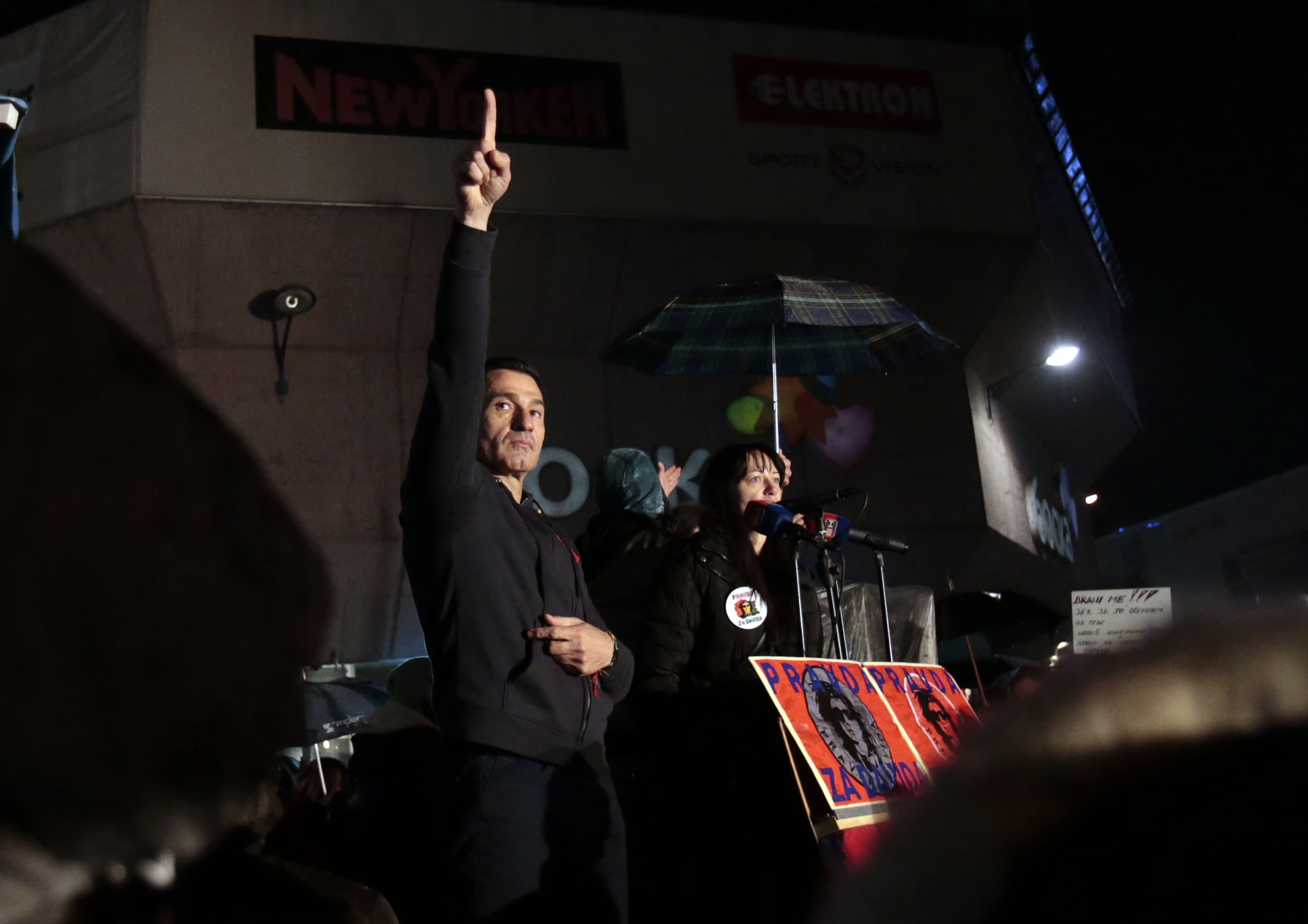 Davor Dragicevic, left, gestures to supporters during a protest in Banja Luka, Bosnia on Sunday, Dec. 30, 2018. Several thousand Bosnians have rallied in support of the man whose quest for the truth about his son's death has turned into a wider movement for justice and rule of law in the Balkan country. The protest on Sunday demanded the ouster of Bosnian Serb Interior Minister Dragan Lukac and top police officials over the death in March of 21-year-old David Dragicevic. (AP Photo/Amel Emric)
