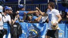 Justin Herbert gets hands dirty with fans at Chargers camp, but will wash them