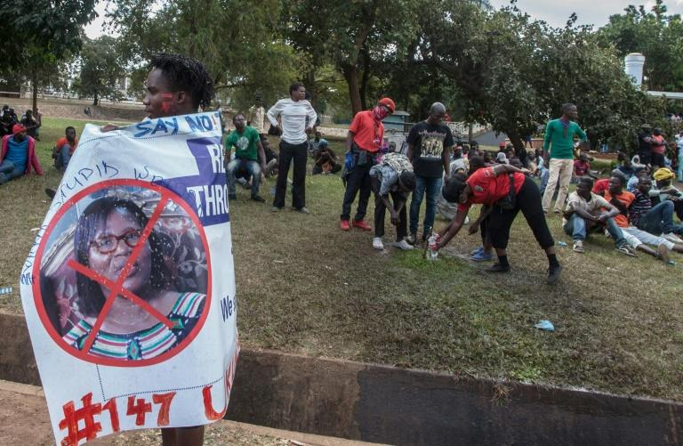 A protester in July carries a banner calling for the ousting of Malawi Electoral Commission chairwoman Jane Ansah