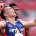 Olympics-Athletics-Warholm destroys world record to win 400m hurdles gold