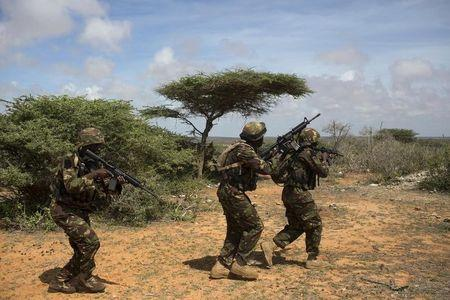 Kenya Defence Forces Rangers secure an area during a foot patrol on the outskirts of the controlled area of the old airport in Kismayu