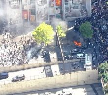 Protesters in Philadelphia set police vehicle on fire