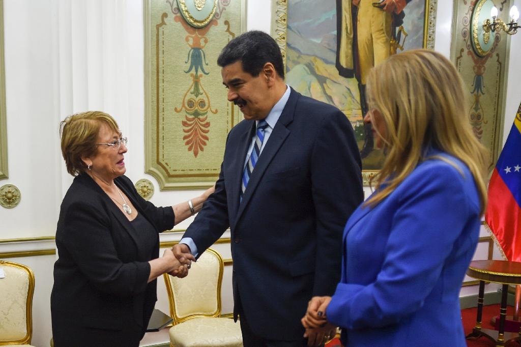 UN High Commissioner for Human Rights Michelle Bachelet (L) called for Venezuelan President Nicolas Maduro (C) to release jailed dissidents