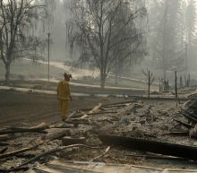 The Latest: Southern California fire toll at 713 buildings