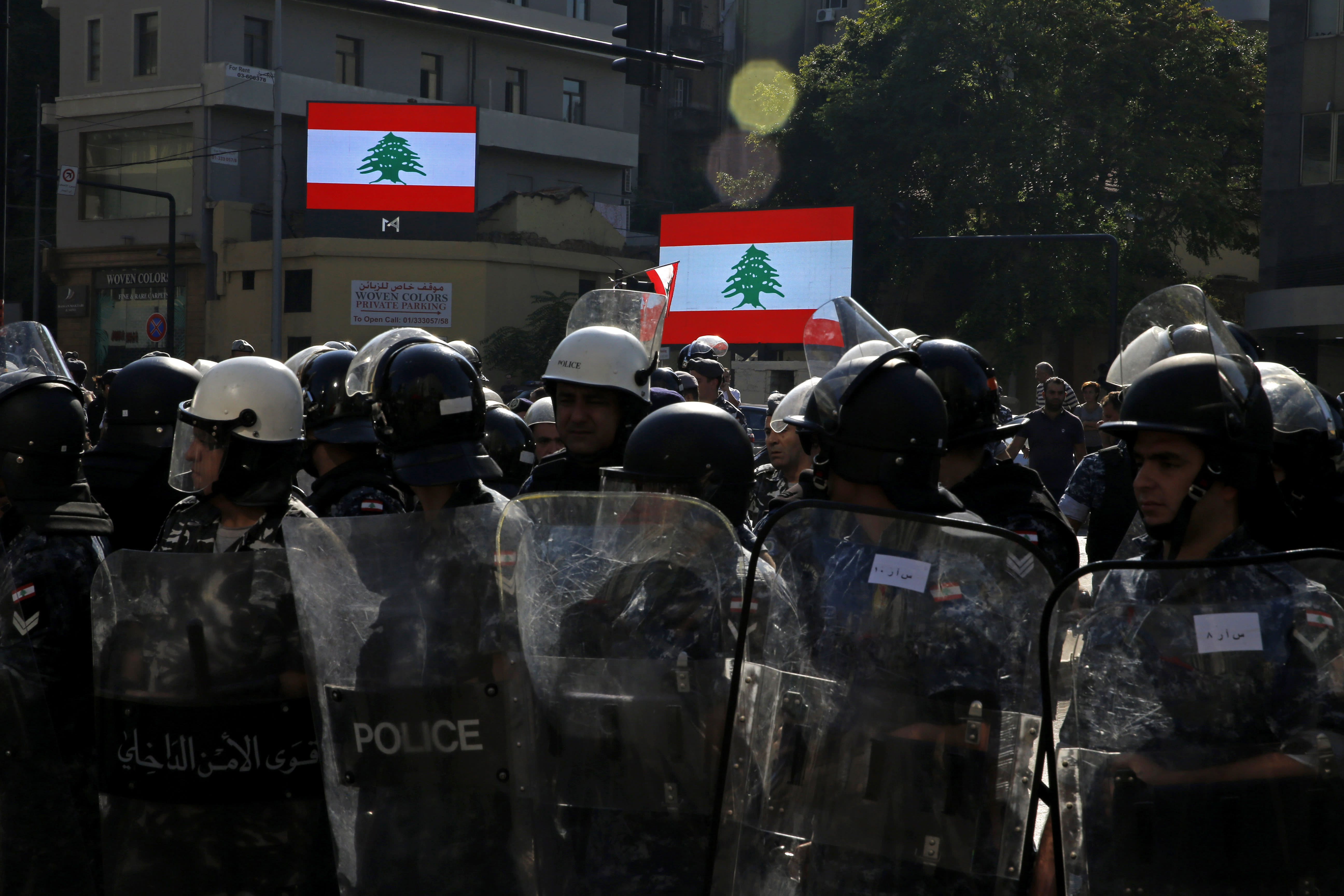 Riot police stand guard after they open a road in Beirut, Lebanon, Thursday, Oct. 31, 2019. Army units and riot police took down barriers and tents set up in the middle of highways and major intersections Thursday. (AP Photo/Bilal Hussein)