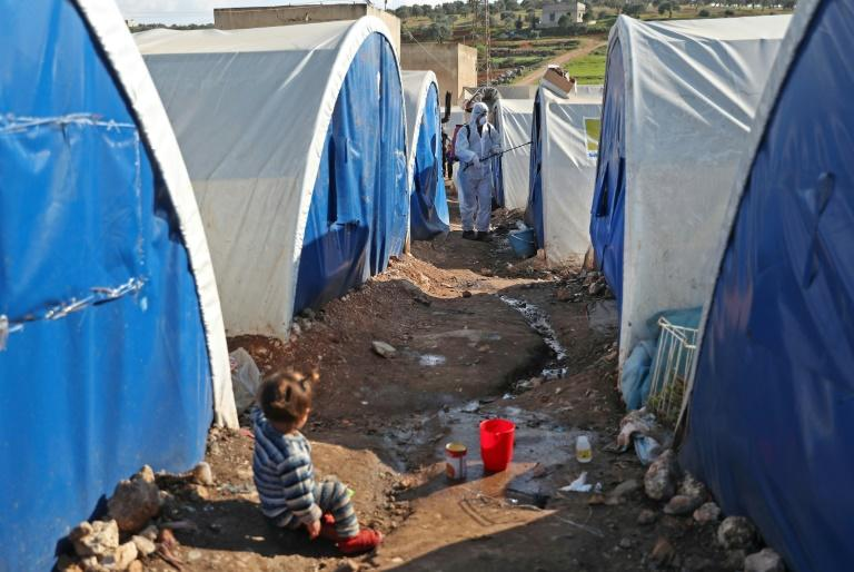 The hundreds of thousands of displaced civilians living in camps in rebel-held northwestern Syria do their best to protect themselves against the coronavirus but the tightly spaced tents and intermittent water supply make it difficult (AFP Photo/Omar HAJ KADOUR)