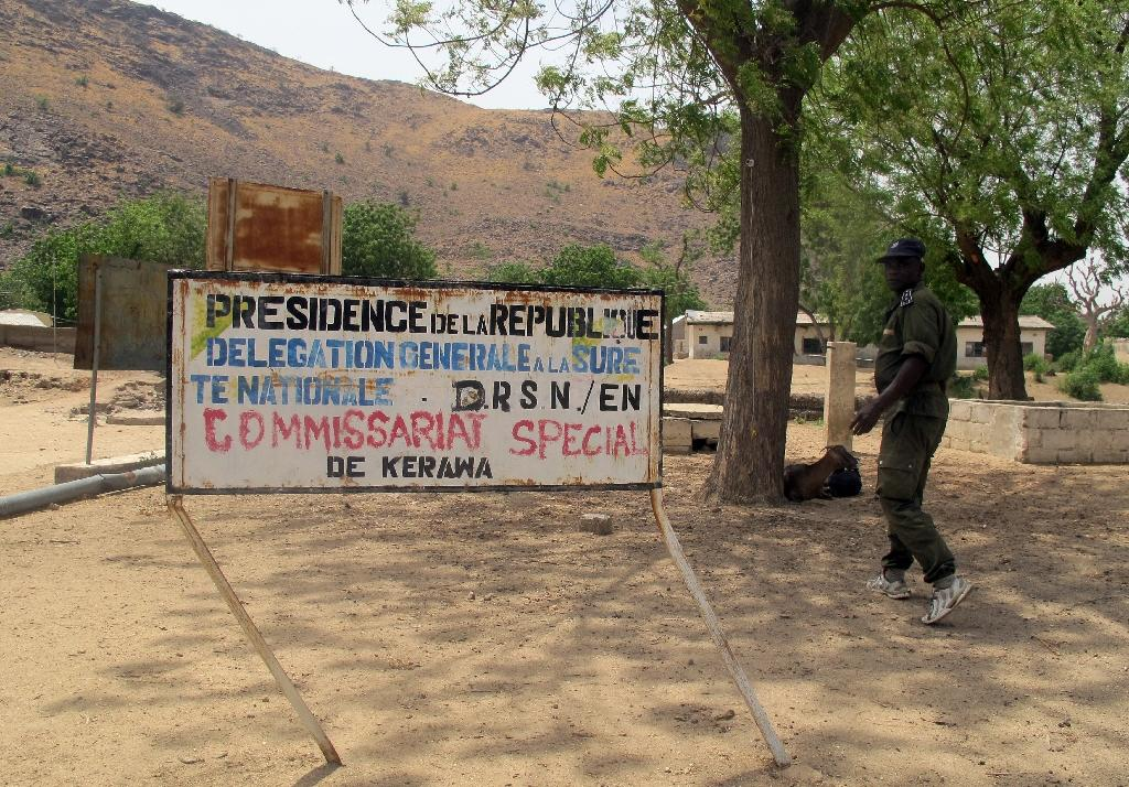 This picture taken on March 30, 2014 shows a soldier standing at the border post of the northern Cameroonian city of Kerawa