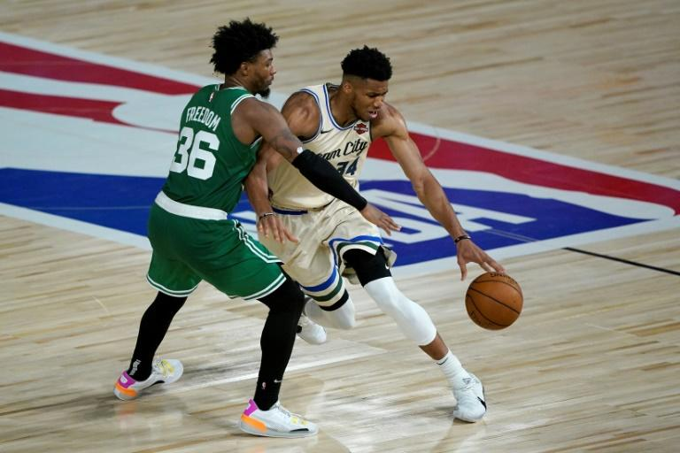 Boston's Marcus Smart, left, was fined $15,000 by the NBA for criticizing referees after a controversial play involving Milwaukee's Giannis Antetokounmpo, right
