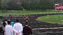 Young athlete doesn't give up after falling during 200m hurdle race